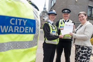 20/05/16 Angela Scott, CEO with Aberdeen city Council presented the Worldhost Plaque to members of the Aberdeen City Wardens team, receiving the plaque were city wardens- Harry Farquhar and Carolyn Bruce.